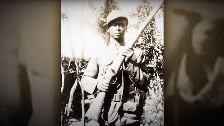 An African American soldier wearing French equipment armed with a M1907/15 Berthier rifle.