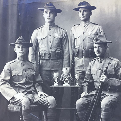 By 1911, Marines were not only winning inter-service rifle matches in the United States, but also winning shooting competitions against international teams in China. Future Commandant of the Marine Corps Thomas Holcomb, who had shot on Harllee's team, is seated on the right.