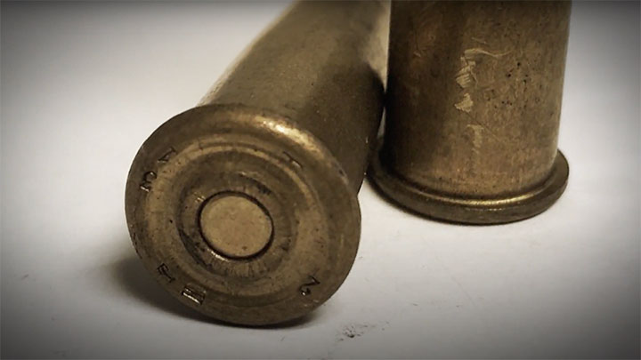 The angular ring on the back of 8 mm Lebel cartridges meant to keep the tips of bullet from igniting the primers when leaded into the M1886 tube magazine.