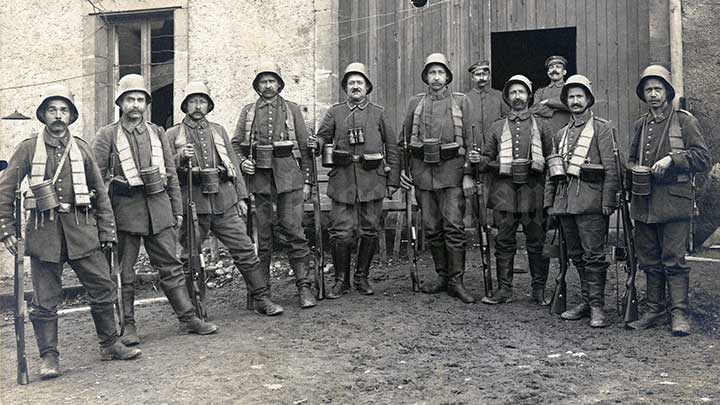 """A group of German soldier pose for a picture later in the war. Note that every Gew 98 in the picture has the extended """"trench magazine."""""""