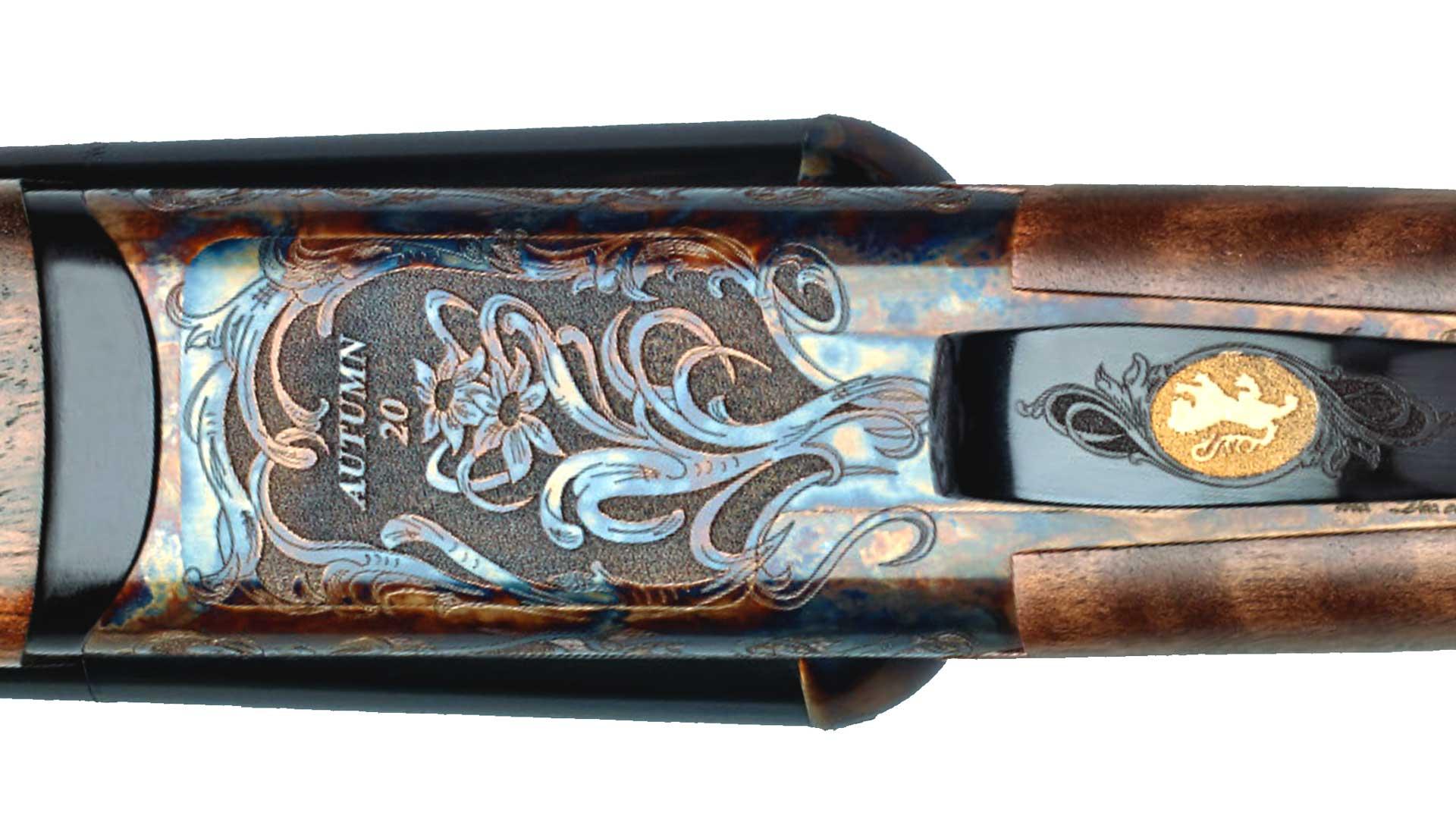 metal engraving gold emblem scrolls flowers gun receiver shotgun