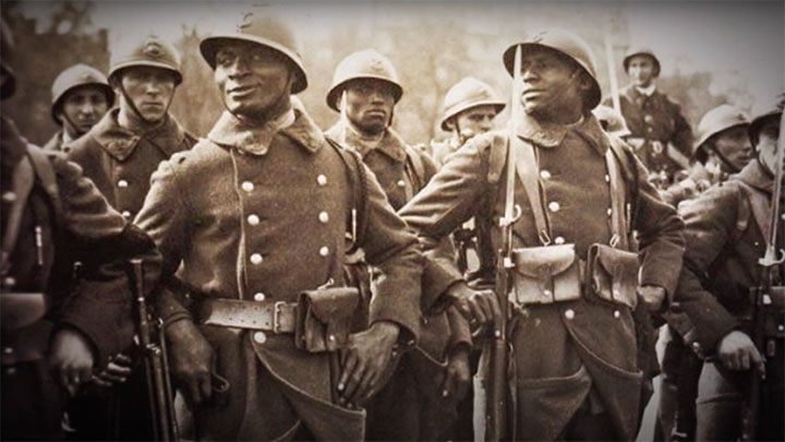 African decent soldiers wearing French gear and uniforms mixed with French soldiers.