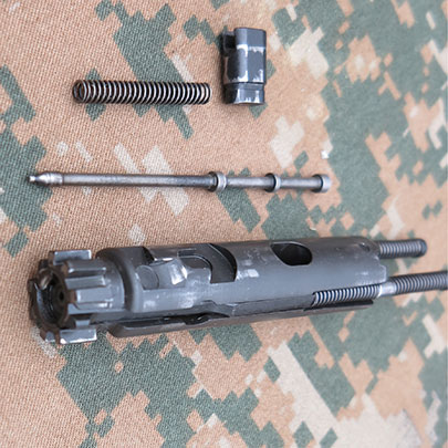 The disassembled bolt carrier group of the ARX 100.