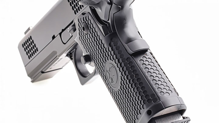 Unique dimpling patterns on the slide match the same pattern found on the aluminum grip panels.  These dimples provide a good surface for grasping the slide. The dimples are not abrasive, but they are aggressive enough to provide a slip-resistant surface.