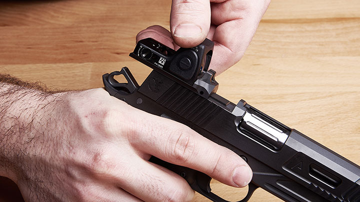 Nighthawk Custom's innovative IOS (Interchangeable Optic System) for those who desire optic compatible handguns.  The IOS allows for a low profile RMR mount with the versatility to switch to rear sight in a matter of seconds.