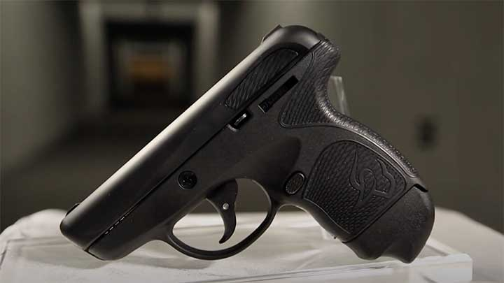 A view of the left side of the Taurus Spectrum with the magazine release and slide catch visible.