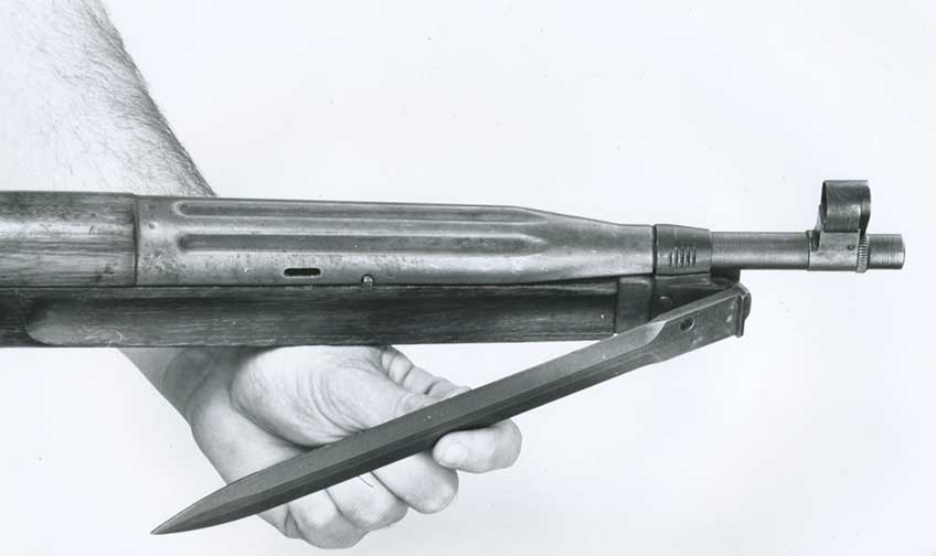 The bayonet is hinged at the fore-end.