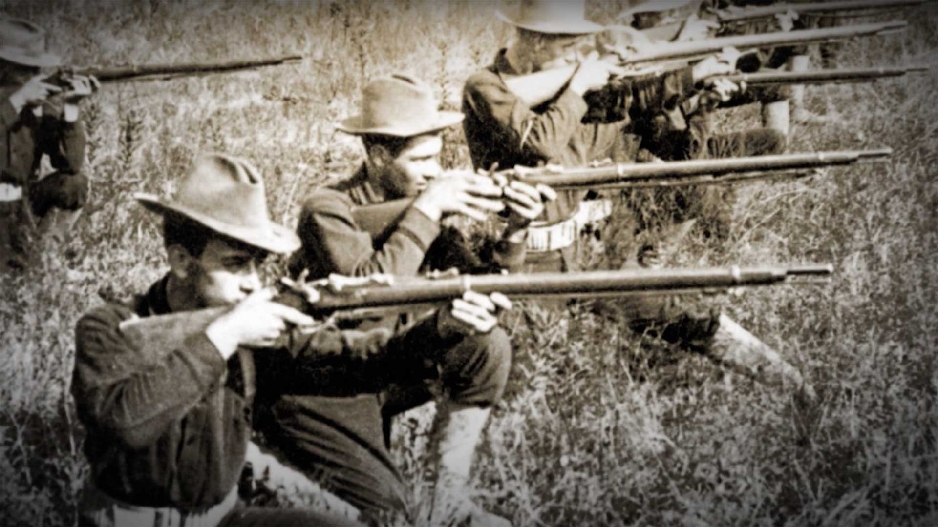 """U.S. troops armed with the Springfield Model 1873 """"Trap-Door"""" breech-loading rifle."""