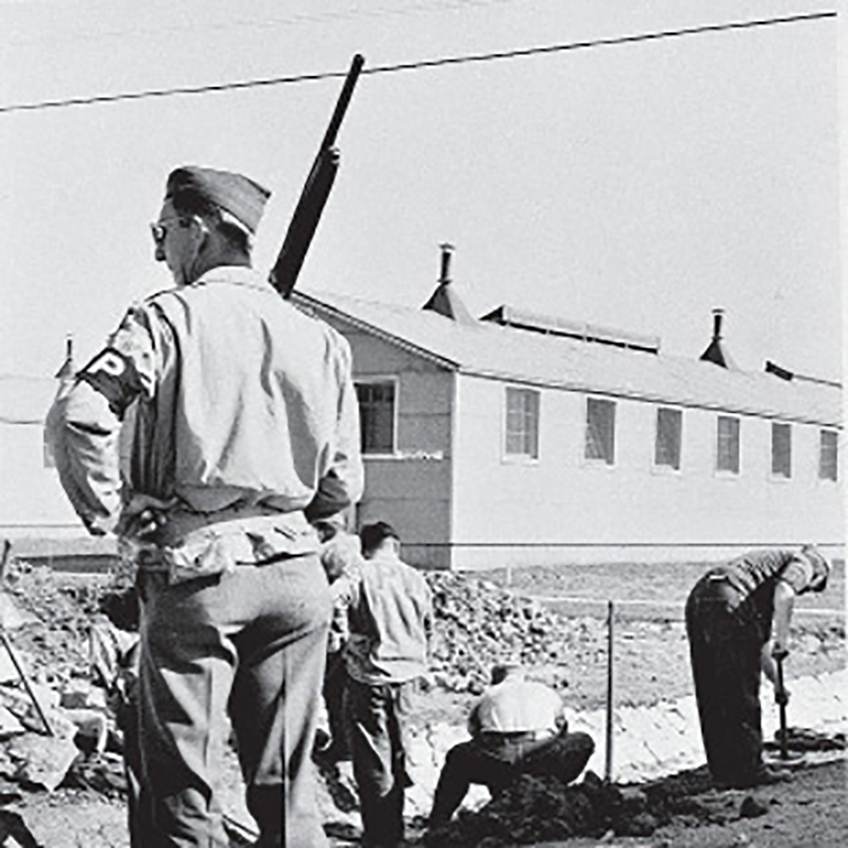 A MP standing guard with a Remington Model 11 in hand.