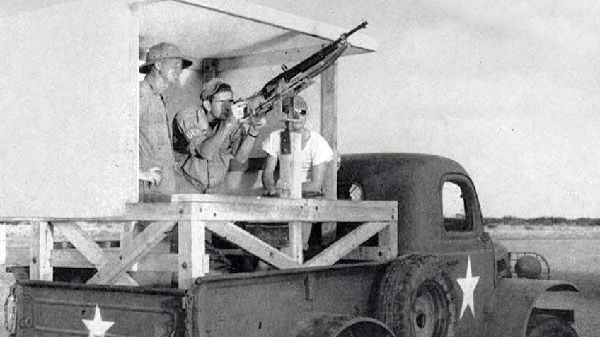A Remington Model 11 set up on an aerial training mount in the bed of a truck. The truck would drive down a course as the trainee engaged targets.