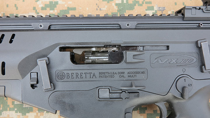 The charging handle of the ARX 100 being swapped to a different side.