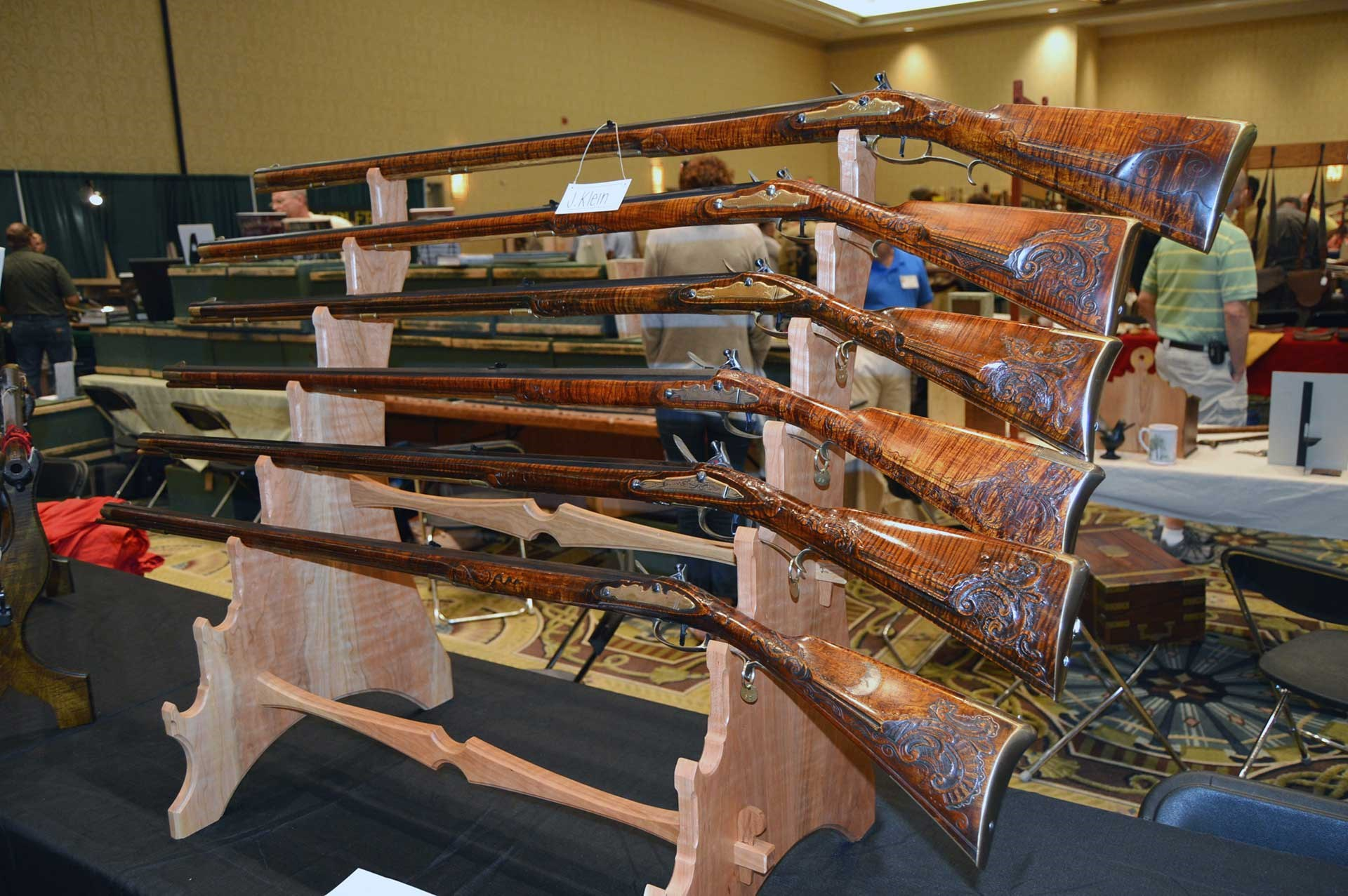 Flintlock longrifles shown on a stand at the CLA Show.