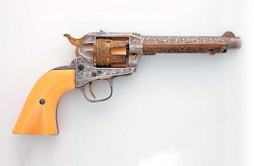 """Engraved by Cole Agee, this historic Ruger Single Six enjoys the distinction of being the first engraved Ruger revolver shipped from the Red Barn. It is gold- and silver-plated and carries an inscription on its backstrap that reads: """"To John T. Amber With The Compliments of Col. Ruger."""" The gun also graced the cover of The Gun Digest's 8th Edition in 1954."""