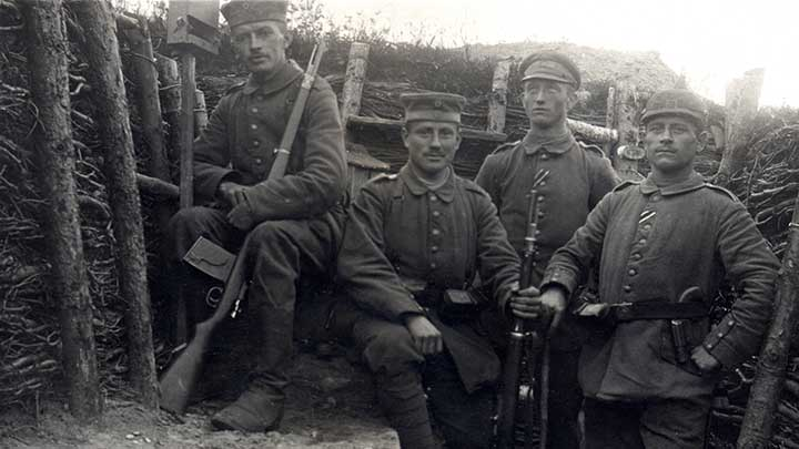 """German soldiers in a trench, the soldier in the background has an extended 25 round """"trench magazine""""  fixed to his Gew 98."""