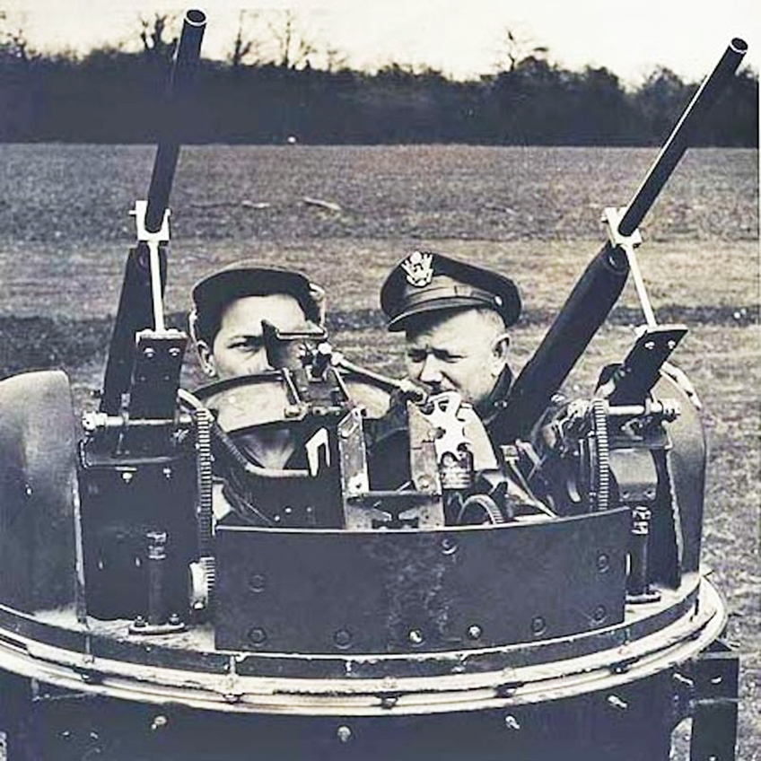 Two Remington Model 11 shotguns mounted into a mock-up twin dorsal turret. This is meant to simulate the dorsal turrets used on many American medium and heavy bombers during World War II, including the B-17 and B-24. The use of 12-ga. shotguns instead of .50-cal AN/M2 machine guns also eliminated the worry of errant rounds in the air during training.