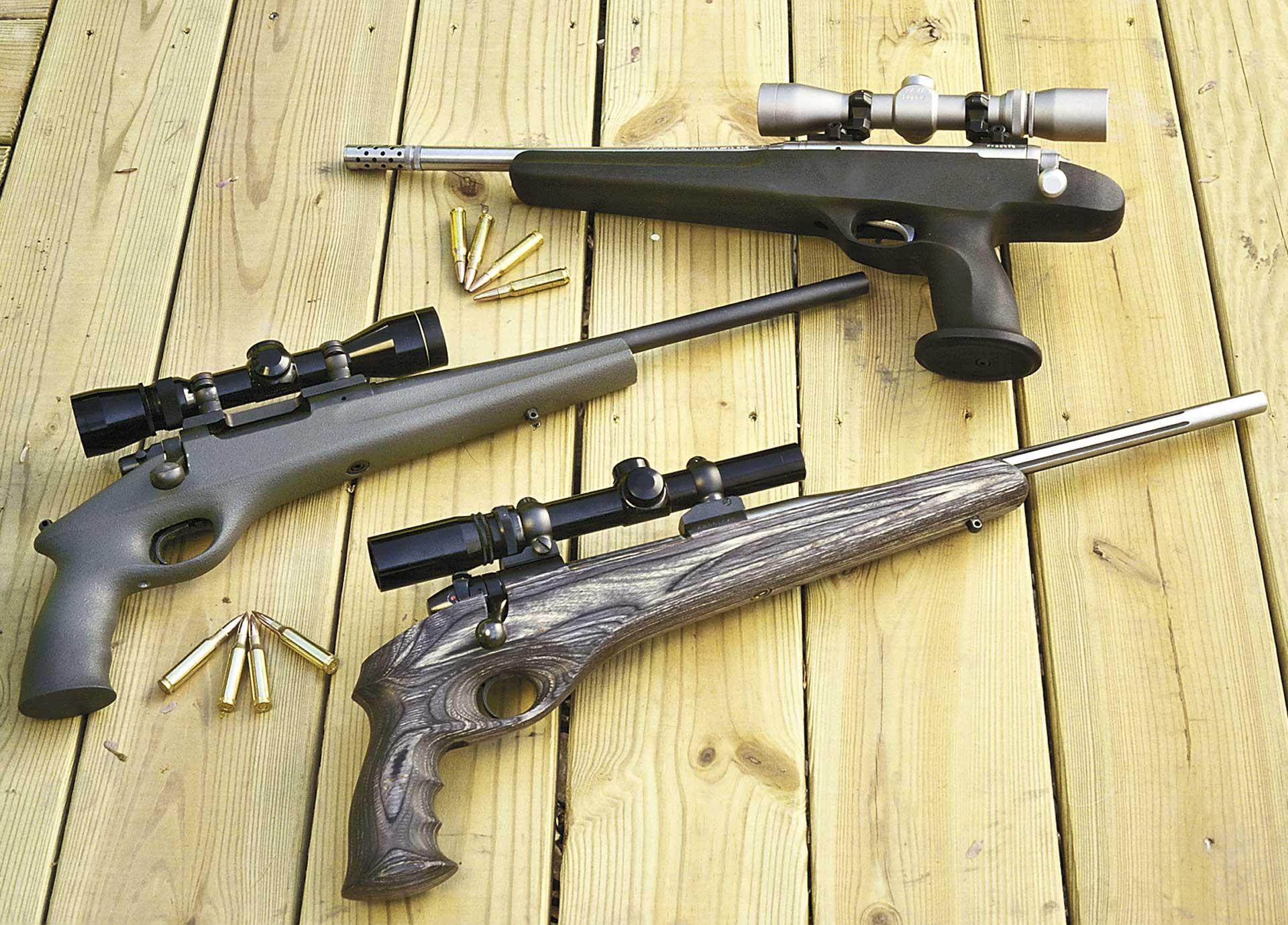 outdoors wood planks baords guns pistols three