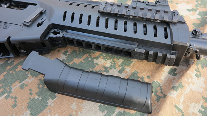The lower panel cover on the fore-end removed to reveal the mount for the GLX 160 40 mm grenade launcher.
